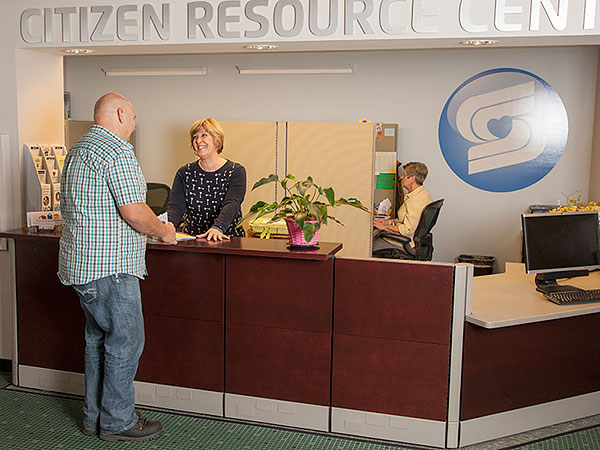 lady serving a male customer at citizen resource center counter