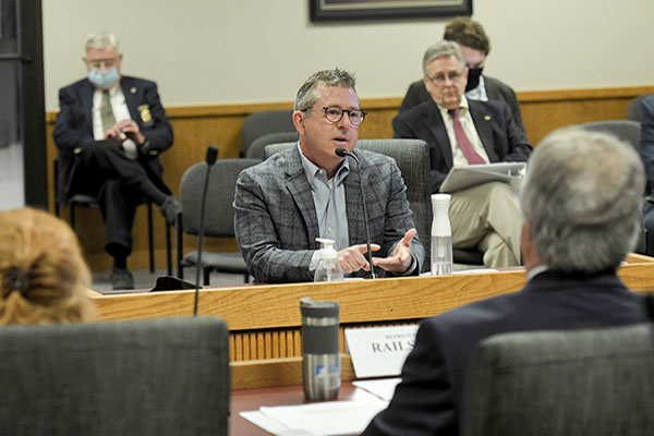 Councilman Richard Ollis testifies before a government committee