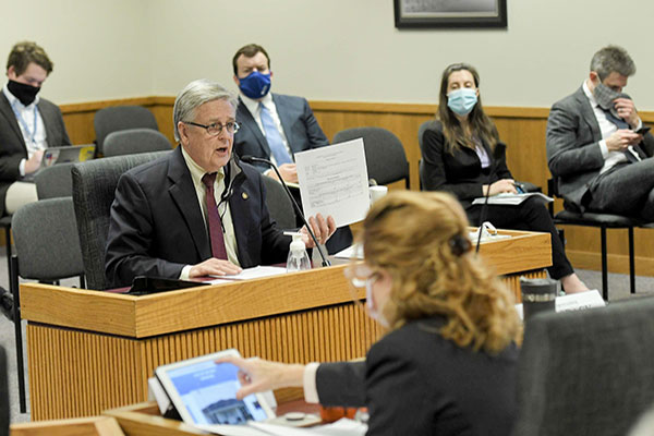 Representative Bill Owen testifies before a government committee